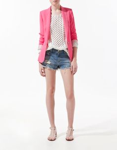 That pink blazer would bring such a refreshing pop of color to a gray officewear outfit.