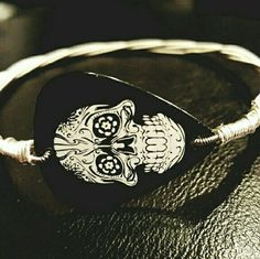 "Skull Pick Guitar String Bangle Bracelet Handmade Skull Guitar Pick Bangle Bracelet. Measuring 3"" in diameter. Never worn. Brand new. Jewelry Bracelets"