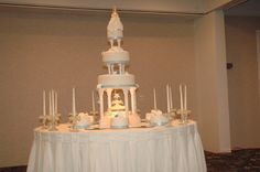 My first Quinceanera - Nine cakes in all - Guava, Coconut, chocolate, vanilla, etc.  The topper was actually made out of fondant - bought by the mother in Florida - it was absolutely amazing!!!!!!!!!