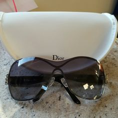 Dior sunglasses. Dior silver frame with black arm sunglasses.  In great condition.  Come with the zip case and soft bag. Puchase in Saks . No low ball plz. Dior Accessories Sunglasses