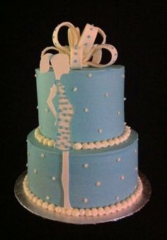 ICED WITH BUTTERCREAM BABY SHOWER CAKES | buttercream, light blue and white cake was created for a baby shower ...