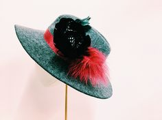 Cecile Millinery , grey felt hat with feather . Handmade in London
