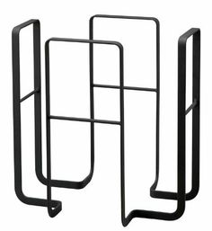 """""""Tower"""" Black Metal Magazine Rack, 13.5"""" H by SunLine. $49.95. Durable metal construction. Designed in Japan. This """"Tower"""" rack organizes your home or office and helps to keep your periodicals neat and tidy.  It holds any standard sized magazine, newspaper and book and is so attractive you'll want to keep it out in the open for all to see. The sturdy metal construction ensures that this holder will beautify your home or office for many years to come. A perfect magazin..."""