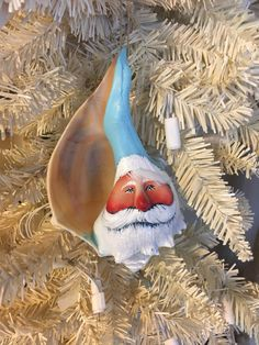 Sea shell Santa Claus huge aqua turquoise blue whelk welk conch nautical Christmas ornament by mypaintinplace on Etsy nauticalchristmas Nautical Christmas, Beach Christmas, Christmas Art, Christmas Projects, Holiday Crafts, Christmas 2017, Christmas Stuff, Christmas Cookies, Christmas Ideas