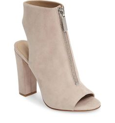 A front zipper heightens the street-savvy style of this sleek peep-toe sandal featuring an open counter and a wrapped block heel.