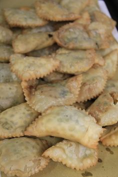 """I gattafin, le """"finezze della gatta"""", ravioloni ripieni del levante ligure. another example of the use of wild herbs as a filling is gattafin, typical of Levanto, in the La Spezia area. They are large, fried ravioli filled with wild herbs, chard, extra virgin oil made from Liguria olives, onions, ricotta, spices, eggs and cheese."""