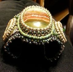 Another view of the Indonesian Pancawarna stone and the beaded bezel around it.