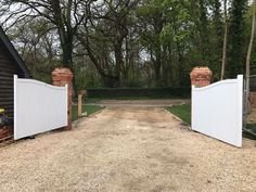 Open driveway gates finished in white. Constructed using redwood pine (softwood). Gate Automation, Gate Post, Gate Hinges, Electric Gates, Wooden Posts, Driveway Gate, Western Red Cedar, Entrance Gates, Gate Design