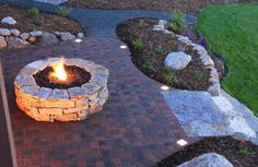 Outdoor gas stone fire pit.  Probably off to the side at one end of the pool, toward the timber probably.