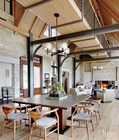 Transitional Neutral Dining Room with Exposed Steel beams