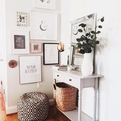 I like the gallery wall, console table, woven basket, graphic pouf... Basically, all of it. I would just add a bit more color.