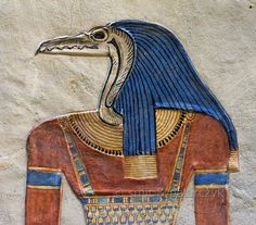 'Gatekeeper in the tomb of Amenherkhepshef.'  This coloured relief in the tomb of Amenherkhepshef portrays a bird headed genie, who accordin...