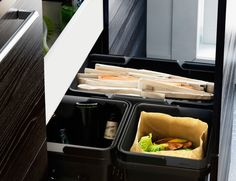 Close-up of open IKEA deep kitchen drawer with recycling bins inside.