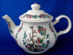 This is a vintage Sadler, England teapot in the Indian Tree or Indian Peony pattern. The 6 to 8 cup ironstone tea pot measures 6.5 inches high by 10 inches long by 6 in diameter and is in excellent us