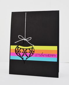 handmade Christimas card ... definitely not traditional colors! ... black card base ... panel/band of neon colors die cut ornament in black put back into the negative space ...WOW! ... Jennifer really is Stamping Royalty ... congratulations!!