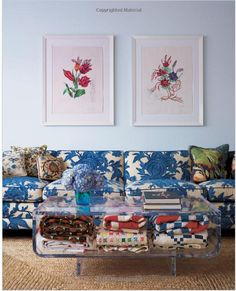 """from """"Good Bones, Great Pieces."""" blue pattern sofa, lucite coffee table, botanical prints, folded blankets"""