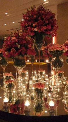 I love using mirrors to reflect light from candles and to make flowers appear more plentiful.