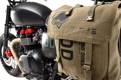 "Triumph's one of a kind custom Metal Gear Solid V T1-100 Bonneville - ""Venom"" Diamond Dog saddle bags"