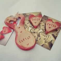 These gorgeous handmade lovespoons and brooches are now back in stock!