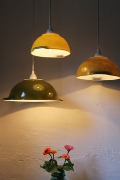 Pyrex bowls upcycled into hanging lamps.  Very cool.