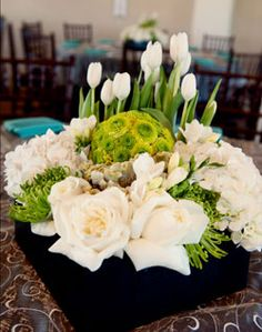 white and green spring is funky and whimsical with the pincushion sphere in the arrangement.