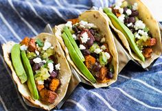 Turn sweet potatoes and black beans into a simple, healthy dinner with these tacos! 30 minute meal.
