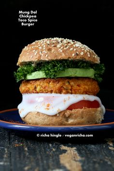 These Spicy Chickpea Lentil Burgers have mung dal, chickpeas and taco spice. Add avocado, chipotle aioli for a delicious burger. Vegan Recipe Gluten-free patty