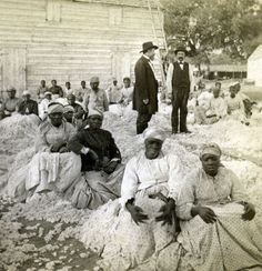 A cotton gin and workers at the Knox plantation in Mount Pleasant, S.C., circa 1874. Photo by George N. Barnard, one of the first people to open a daguerreotype studio in the United States. He followed Union Gen. William Tecumseh Sherman's 'March to the Sea' and in 1866 published an album of 61 renowned photographs, Photographic Views of Sherman's Campaign.