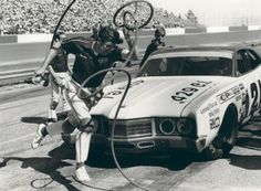 Leonard Wood of the Wood Brothers Racing team high steps a pit stop old school style