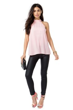 Need to show off those sculpted shoulders and that signature tattoo? This top is absolutely perfect, featuring a mock collar and sexy lace trim. Keyhole back with double button closures. Loose fit. Finished edges, Complete the look with a sleek leather skinny and black clutch. $17.90