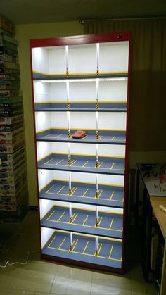 Creative model car display cabinet looks like lighted parkin.-Creative model car display cabinet looks like lighted parking garage. – Creative model car display cabinet looks like lighted parking garage. Hot Wheels Storage, Hot Wheels Display, Car Storage, Garage Storage, Vitrine Pour Collection, Model Auto, Model Car, Art Carton, Cool Old Cars