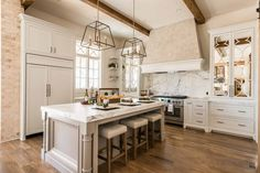 Mirrored kitchen cabinets not only add a little extra elegance to your kitchen -- they can also make the space feel larger and brighter.