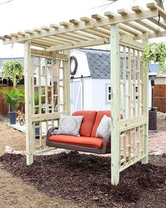 This is the best seat in the house! We purchased the swing and made the stand- I can't wait for the plants to start growing up the trellis! #outdoor #swing #outdoorswing #diy #trellis #backyard
