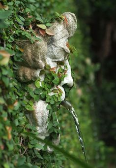 WALL FOUNTAIN: Face among the Ivy.