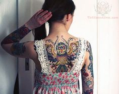 Open wings owl tattoo