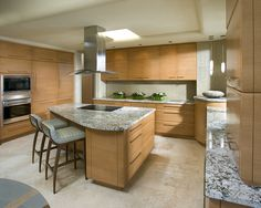 Removing a wall opens this kitchen to the adjoining family room. Simple linear grained robinwood cabinetry creates a soothing simplistic space while all cooking needs are readily accessible.    Winner: 1st Place Residential Total Remodel, 2008 ASID Arizona North Chapter Design Excellence Award