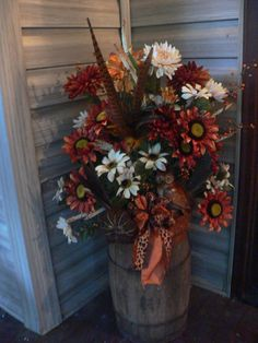 Fall flower arrangement Rust Browns Creams Vintage Wooden Barrel