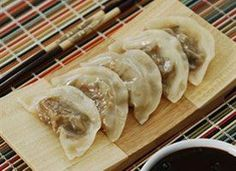 These Steamed Vegetable Dumplings are flavorful filled pasta bites, stuffed with a cabbage mixture and dipped in soy sauce. I'm head over heels for them.