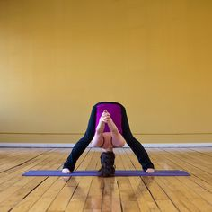 Wide-Legged Forward Bend C is another relaxing pose that will loosen up your shoulders and help you destress before bed: From Standing Forward Bend, slowly roll up vertebrae by vertebrae until you're standing at the top of your mat. Stand with your