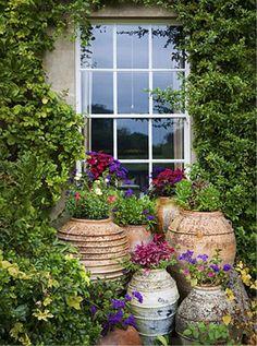 Cretan pots at Highgrove  pinned by www.ukgardening-directory.co.uk