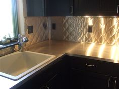 Stainless Steel Counter Top & Quilted Backsplash.
