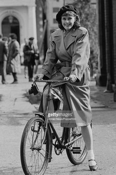 English actress Kirsten Cooke posed sitting on a bicycle in character as Michelle Dubois from the television sitcom series 'Allo 'Allo! on location in Mundford, Norfolk on 22nd April 1986.