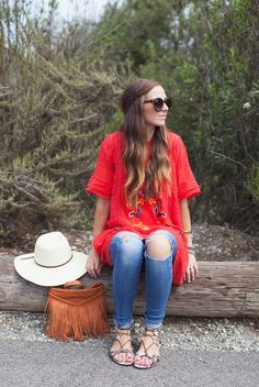 spring / summer - street style - summer outfits - beach outfits - festival outfits - red embroidered ruffle dress + distressed skinny jeans + white wide brim fedora, brown fringe shoulder bag + tortoise sunglasses