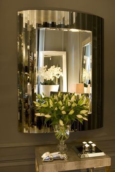 Linea Mirror   An exquisite art-deco inspired mirror with smoke grey glass mirror strips in a fluid curved design. As with all our pieces, this mirror has been handmade in England. Also available with silver glass mirror strips.