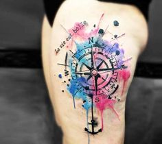 Very pretty watercolor tattoo style of Compass motive done by tattoo artist Kenlar Tattoo