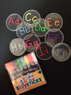 Using these great Sillysticks and the lids from empty Pringles cans, I made a set of Alphabet manipulativives. $0 cost, so many activities/games to play with them!