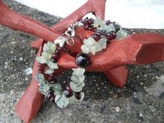 Check out this item in my Etsy shop https://www.etsy.com/listing/221376053/garnet-and-prehnite-double-row-bracelet
