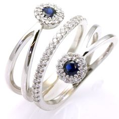 14K white gold, diamond and sapphire anniversary band.  The ring holds two sapphires with total weight of 0.44 ct and 50 round brilliant cut diamond with total weight of 0.40ct. The diamonds are graded as VS in clarity G-H in color. The ring is approximately 18.0 mm wide. The finish is polished. Different finishes may be selected or specified.