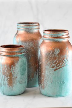 Use reactive metal paints to create these copper mason jars with a blue patina.