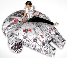 I want! This giant Millennium Falcon beanbag chairbed was found on www.geekologie.com
